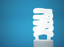 Energy saving lightbulb. Energy saving light bulb on blue background Stock Photo