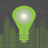 Energy saving lightbulb in front of the skyscrapers. Eco lighting concept. Big green energy saving lightbulb in front of the skyscrapers silhouettes. Digital Royalty Free Stock Image