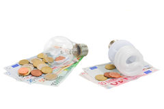 Energy saving and normal bulbs on euro money. Energy saving and normal lamp bulbs on euro money isolatd on white stock image