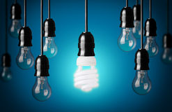 Energy saving and simple light bulbs. Idea concept onblue background Royalty Free Stock Image