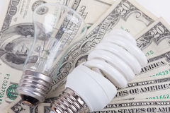 Energy saving, traditional lamps and dollars closeup stock photo
