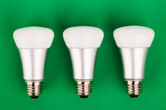 Energy saving wifi light bulb on green  background. Royalty Free Stock Photo