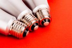 Energy saving wifi light bulb on red  background. Stock Photos