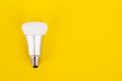 Energy saving wifi light bulb on yellow background. Internet, energy saving and  digital lifestyle concept Royalty Free Stock Images