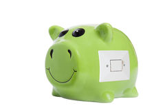 Energy savings concept. Close up of piggy bank with light switch Stock Images