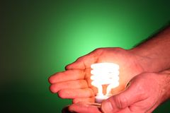 Energy savings in our hands Stock Photo
