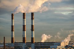 Energy. Smoke from chimney of power plant or station. Industrial landscape. Royalty Free Stock Photography