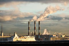 Energy. Smoke from chimney of power plant or station. Industrial landscape. Stock Photo