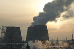 Energy station with smoke at winter sunset Stock Photography