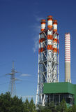 Energy - Thermoelectric power plant. ENERGY - Thermoelectric power station against blue sky Royalty Free Stock Photo