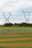 Energy tower in cultivated land Royalty Free Stock Image