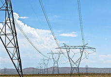 Energy Transmission Lines Across Desert Royalty Free Stock Photo