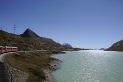 Energy: water power from glacier lake Lago Bianco at Bernina Hos. Pitz in the upper Engadin Stock Photo