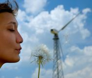Energy of wind. Woman and dandelion flower wind energy concept royalty free stock photos