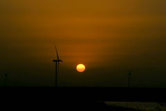 Energy wind turbine rotating fields at sunset. Wind energy as a clean, renewable energy, more and more attention around the world. Wind has long been use Stock Image