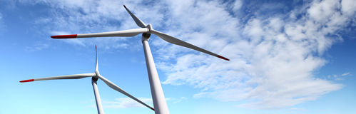 Energy wind turbines on blue sky with clouds Stock Photos
