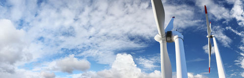 Energy wind turbines on blue sky with clouds Royalty Free Stock Photos