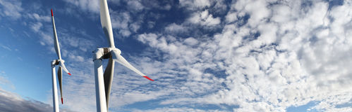 Energy wind turbines on blue sky with clouds Stock Photography