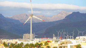 Energy wing power turbine rotates on sunset mountains background. Full HD footage stock footage