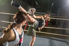 Energy women practicing body combat attack Stock Image