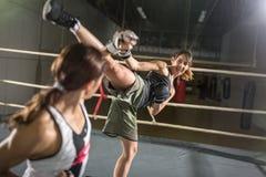 Energy women practicing body combat attack Stock Image