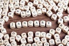 Enero, letra corta palabra en cuadritos imágenes de archivo libres de regalías