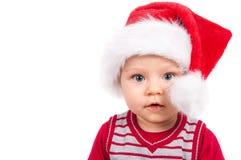Enfant adorable de Noël dans un chapeau rouge photos stock