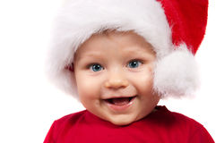Enfant adorable de Noël dans un chapeau rouge photographie stock libre de droits