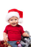 Enfant adorable de Noël dans un chapeau rouge images libres de droits