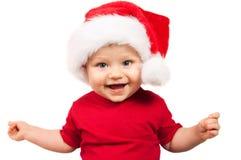 Enfant adorable de Noël dans un chapeau rouge photos libres de droits