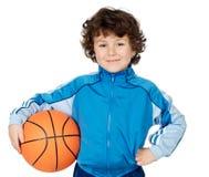 Enfant adorable jouant au basket-ball Image stock