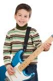 Enfant adorable jouant la guitare électrique Photo libre de droits