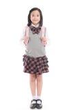 Enfant asiatique dans l'uniforme scolaire avec le sac d'école rose dessus Photo libre de droits