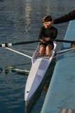 Enfant au cours de aviron Photographie stock libre de droits