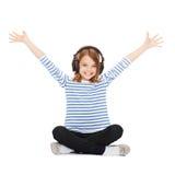 Enfant avec des écouteurs Images libres de droits