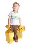 Enfant avec des cadeaux photos libres de droits