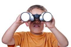Enfant avec des jumelles Photographie stock libre de droits