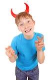 Enfant avec des klaxons de diable Image stock