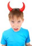 Enfant avec des klaxons de diable Images stock