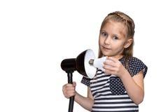 Enfant avec l'ampoule Photos stock
