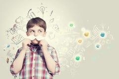 Enfant avec la moustache Images libres de droits
