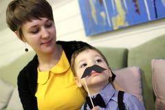Enfant avec la moustache de jouet Photos libres de droits