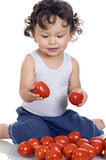 Enfant avec la tomate. Images libres de droits