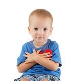 Enfant avec le blanc d'isolement par symbole de coeur Concept de l'amour et de la santé Photos stock
