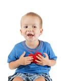 Enfant avec le blanc d'isolement par symbole de coeur Concept de l'amour et de la santé Image stock