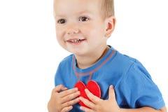 Enfant avec le blanc de symbole de coeur Concept de l'amour et de la santé Images stock