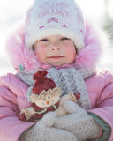 Enfant avec le bonhomme de neige Image stock