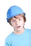 Enfant avec le casque de construction photo stock