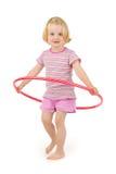 Enfant avec le cercle de hula Image libre de droits