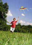 Enfant avec le cerf-volant Photos libres de droits